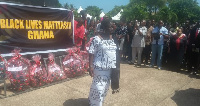Mrs Elizabeth Ofosu-Adjare walking on after laying a wreath