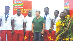 Members of the Black Cranes pose with officials of De United Foods