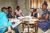 A primary school teacher (right) conducts a lesson in Kagote Village, Fort Portal City