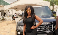 Benedicta Gafah poses with her Range Rover