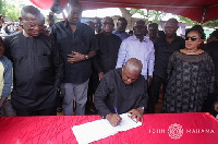 Former President Mahama signing the book of condolence at the one week celebration of Jewel