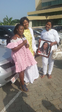 Gifty Osei with her mother and other at the car park