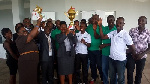 Staff of NDK and players of NDK Financiers pose with the trophies