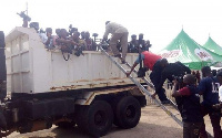 Some Journalists packed in a bucket of the truck