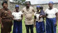 Ibrahim Oppong Kwarteng with the mother and her two daughters rescued from prison