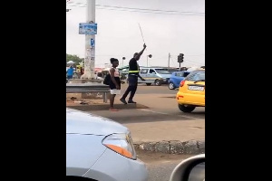The MTTD officer using a cane to redirect disobedient pedestrians