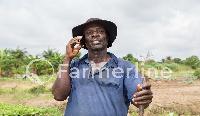 A happy farmer who works with Farmline Limited