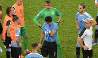 Teary Suarez being consoled his teammates