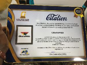 A photo of the award GhanaWeb grabbed at theGolden Age Creative Arts Awards