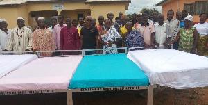 Nana Atta Foster Owusu III with elders and CHPS workers
