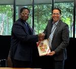 Professor Tony Travaglione, the Interim Deputy Vice-Chancellor with H.E Dr.  Joseph Agoe