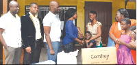 Ms. Mimi Anaman (4th left) joined by colleagues staff to hand over the items to Mrs. Makafui Agbeko