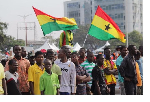 File photo: The Ghanaian flag, and people