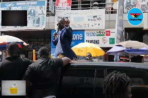 Kofi Akpaloo Speaking To Business Operators At Makola
