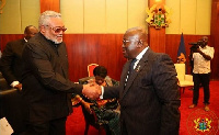 Former President Rawlings and President Akufo-Addo exchanging pleasantries