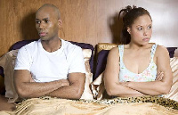 Unhappy couple in bed (file photo)