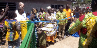 Queen Mother for the Area, DCE & Tullow Officials cutting the tape