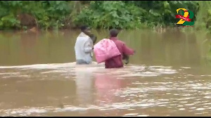 The bridge on the River Bisi has been submerged affecting the movement of the residents.