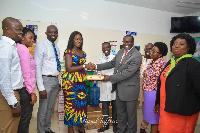 Matilda Hammond donating to officials at GIMPA clinic