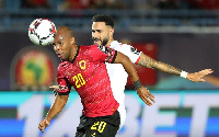 Angola's Eduardo is being battled for the ball