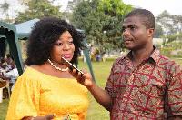 Hon. Pokuah Sawyerr speaking to a journalist