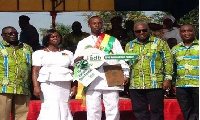 Then President Mahama in a pose with 2016 National Best farmer, Mr Crentsil