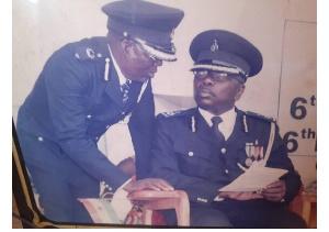 DCOP Ayensu Opare Addo (seated)