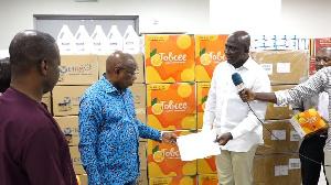 Kwaku Agyemang-Manu receiving the medical supplies from Tobinco