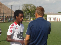 Majeed Ashimeru taking instructions from the Coach