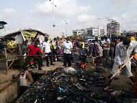 Residents of Korle Klottey Municipal Assembly during the clean-up exercise at Tema station