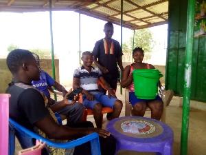 DAvid Attiah with some community members