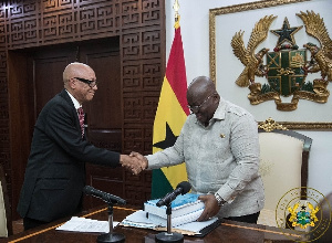 Justice Emile Short presenting the commission's report to President Akufo-Addo