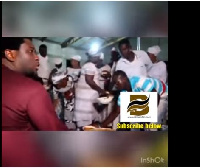The Pastor was seen sitting and sharing the Fufu and cow meat himself