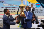 Emmanuel Kofi Nti, General Commissioner of GRA with the trophy