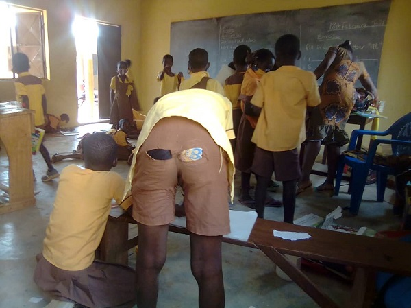 Pupils lie on belly to study at Gumo D/A Primary School 1
