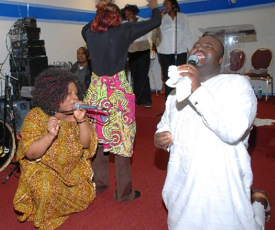 Worshing moment featuring Gospel Star; Felicity Amoah (left,