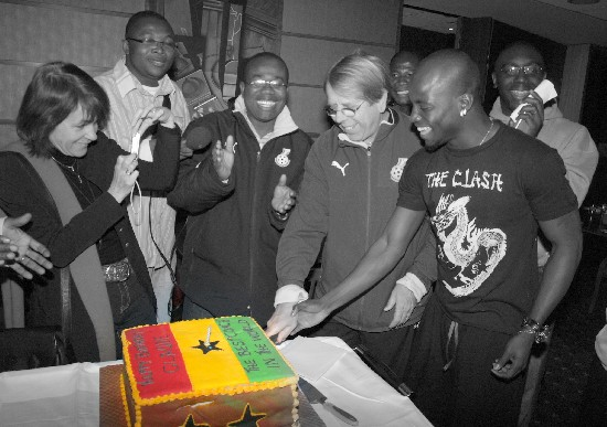 Captain Appiah (right) helps his coach; Leroy cut his birthday cake. Mr. Nyantakyi and others offered an applause.