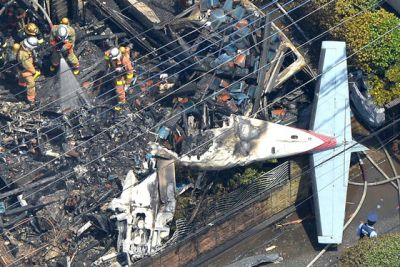 Small aeroplane crashes into suburb, sets fire to houses, cars