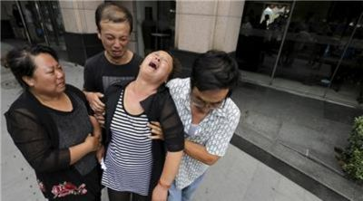Pictures: Chinese industrial explosion, 104 dead