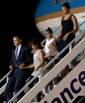US President Barack Obama (L), along with First Lady Michelle Obama (R) and daughters Sasha (2nd R) and Malia (2nd L) disembark from Air Force One upon arrival in Accra, Ghana. Obama arrived in Ghana on Friday on his first trip to sub-Saharan African since taking office to a red carpet welcome with thousands lining the streets to catch a glimpse of America's first black president.