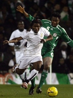 Laryea Kingson, left, is challenged by Nigeria's Jon Obi Miekl for the ball
