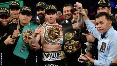 Saul 'Canelo' Alvarez beats Gennady Golovkin on points to take WBC and WBA middleweight titles