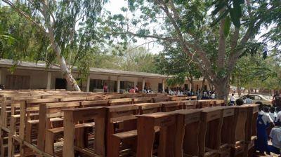 Afenyo Markin presents 290 desks to University Practice school