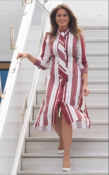 Melania Trump arrives in Ghana wearing red and white striped Celine dress