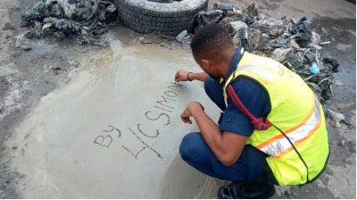 Police officer desilt choked drains, constructs concrete slab with his own money