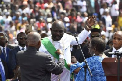 How has Liberia's George Weah performed as a president?