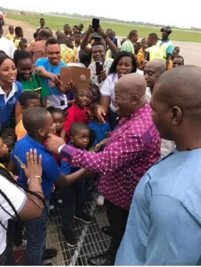 School children get a big treat as they bump into Akufo-Addo at Kumasi Airport