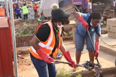 Jospong Ladies Club cleans Madina Market to commemorate International Women's Day
