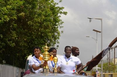 Prisons Ladies present FA Cup trohpy to Prisons boss